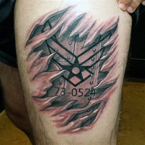 air force symbol tattoo designs mens ripped skin air thigh of plane wing