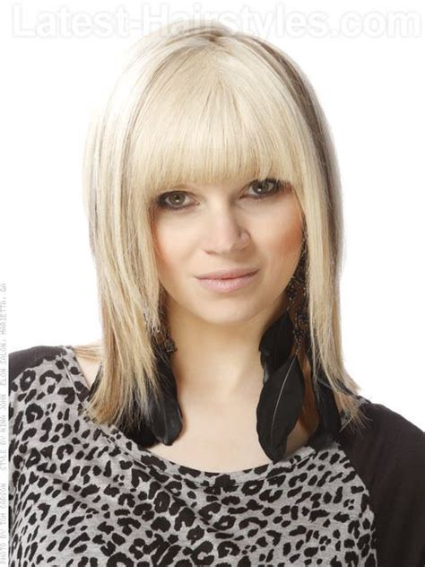 slightly longer in front hair cuts classic blonde shag cut with long bangs front view bangs
