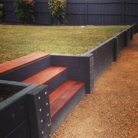 Painting Treated Pine Sleepers retaining wall in newtown kardinia landscape constructions