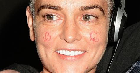 tattoo of us connor sinead o connor shows off new b q cheek tattoos cheryl