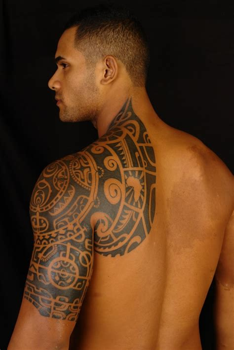 trapezius tattoo of the rock chest tattoomagz