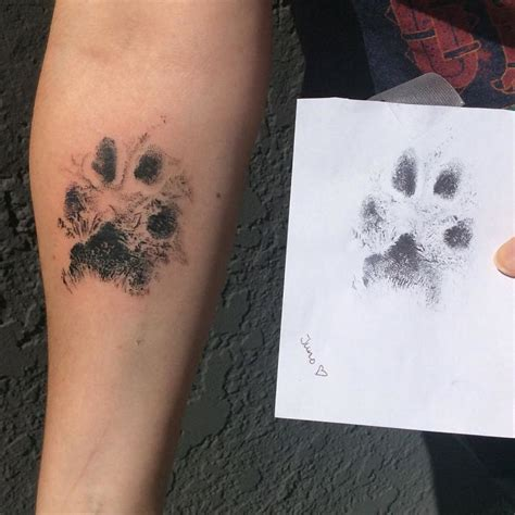 people are using their dog paw prints to make tattoos and