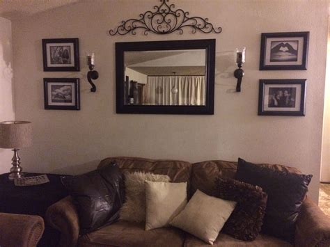 living room wall hangings behind couch wall in living room mirror frame sconces
