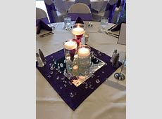 3 tier cylinder vases with submerged purple calla lilies ... Rose Petals And Candles Ideas