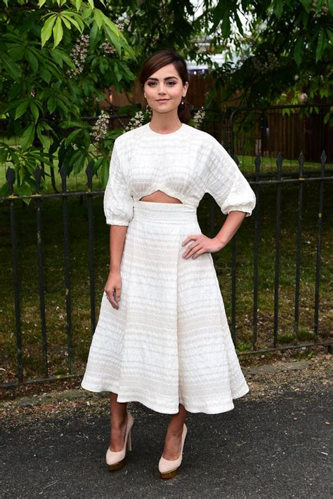Janna Dress coleman displays toned midriff in cut out dress as