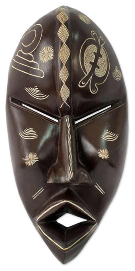african mask with adinkra symbols traditional home