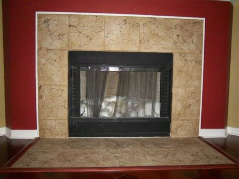 candi in refinishes tile fireplace surround