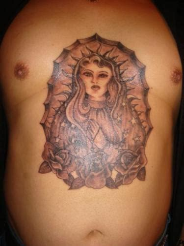mary rose tattoo with roses in goddess like design for
