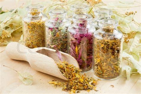 1454930667 the handmade apothecary healing herbal healing herbs in glass bottles herbal medicine stock