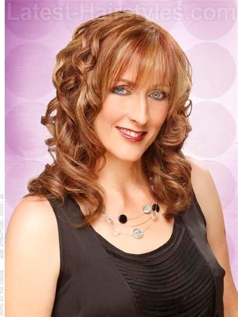 Hairstyles With Bangs And Curls by The Newest Haircuts For Oval Faces