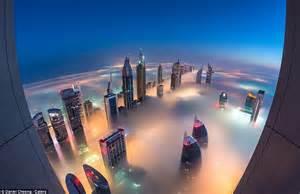 How To Go To World From Dubai Photos Show Dubai Skyscrapers Piercing Through Fog Daily