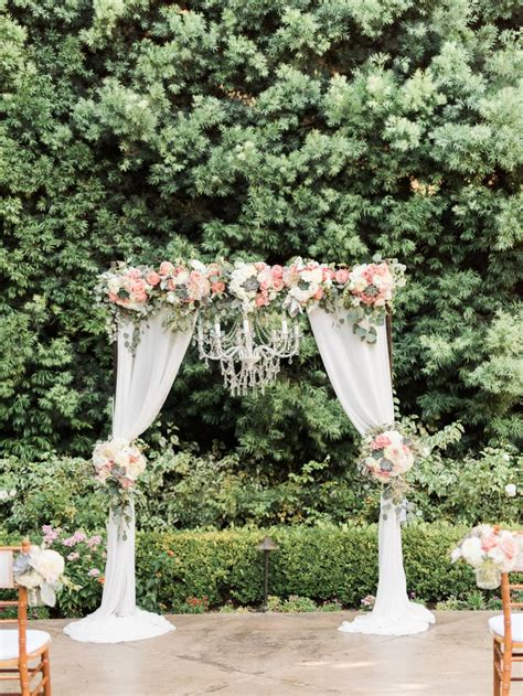 draping flowers for weddings wedding ceremony arch with draping fabric and chandelier
