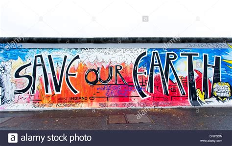 berlin wall mural 06 12 2013 save our earth berlin wall mural berlin germany stock photo royalty free image