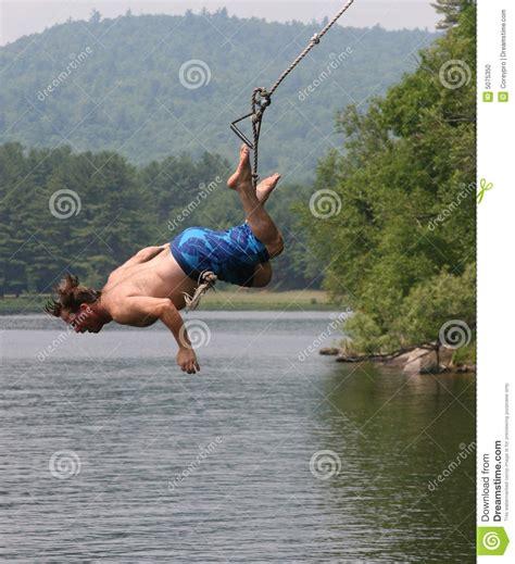 rope swing into lake lake swing stock photo image 5075350