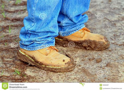 walking shoes coated with mud royalty free stock