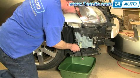 how to change a windshield washer pump on a 1997 geo metro how to install replace windshield washer pump nissan maxima 04 08 1aauto com youtube
