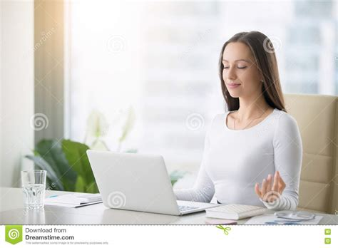 yoga studios hiring front desk near me young woman practicing meditation at the office desk stock