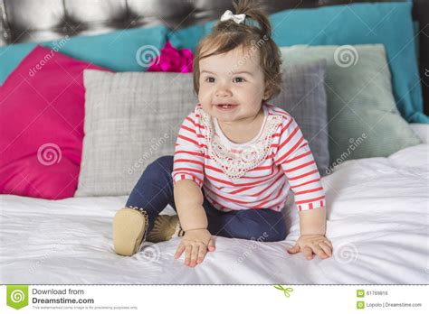bed for one year old one year old girl in bed stock photo image 61769816