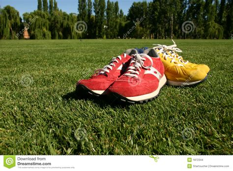 yellow running shoes song and yellow running shoes on a sports field stock