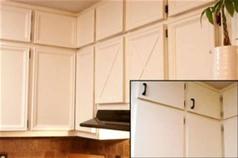 inexpensively update old flat front cabinets by adding 5 kitchen cabinet updates for under 100 the kim