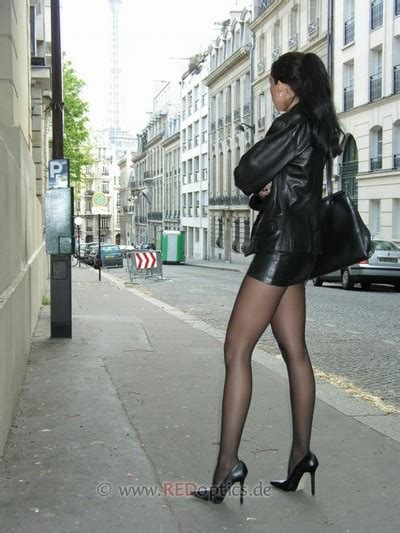stella in black high heels and leather mini