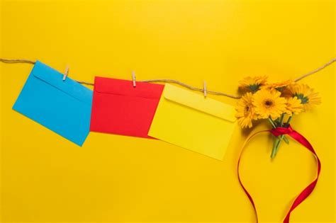 colorful envelopes colorful envelopes and flowers hanging photo free
