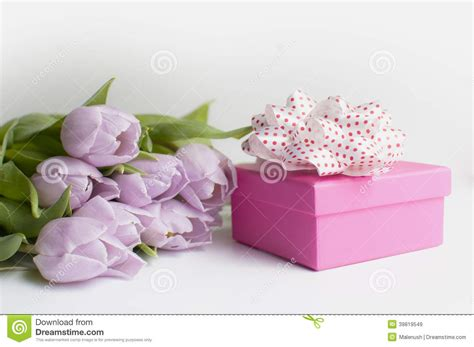 Skinnova Whitening Complete Day Pink bouqet tulips and gift on the white background stock image image 39819549
