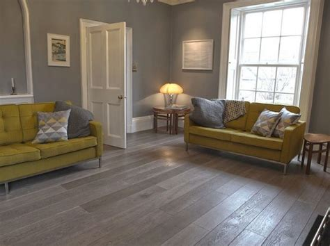 grey wood laminate flooring  living room  yellow