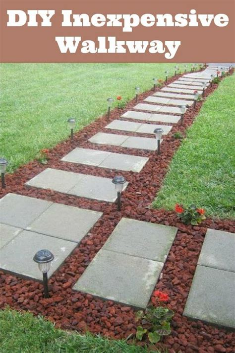 rock pathway ideas front walkway built out of inexpensive cement pavers