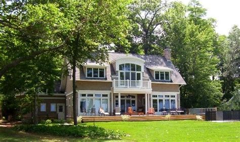 michigan lake house back of house with unobstructed views of lake michigan