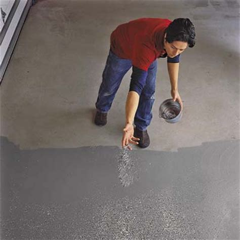 Apply the color flakes   How to Epoxy Coat a Garage Floor