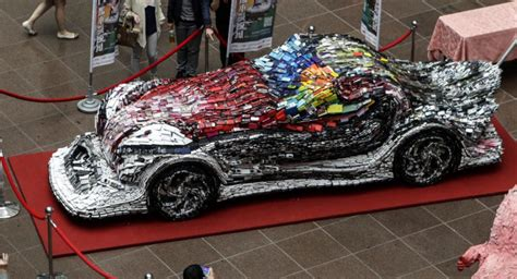 artist  recycled cell phones  build car  news wheel