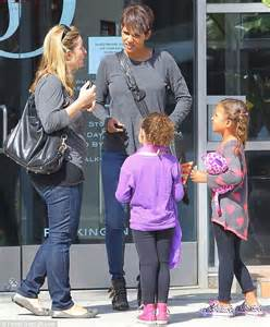Name Halle Berrys Black Handbag by Halle Berry Halle Berry Looks Casual In Skinnies And