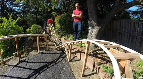 awesome backyards for kids awesome dad builds backyard roller coaster for his two kids