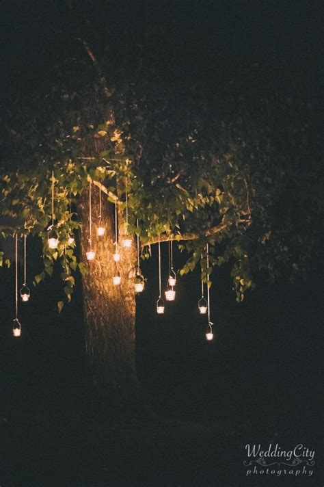 Outdoor Hanging Lights For Trees 25 Hanging Candles Ideas On Hanging Candle Holders Outdoor Events And Glass
