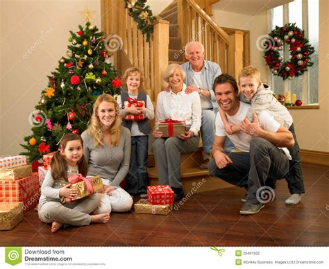 family at home around christmas tree stock photo image