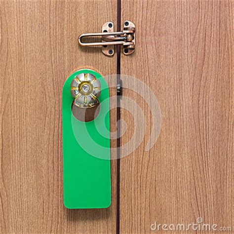 Hanging On Door Knob by Warning Do Not Disturb Green Stock Photo Image 57355122