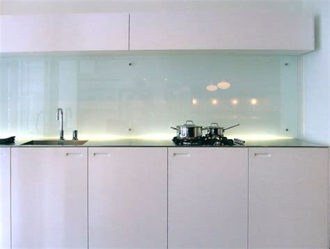 white gloss kitchen with glass splash back kitchen