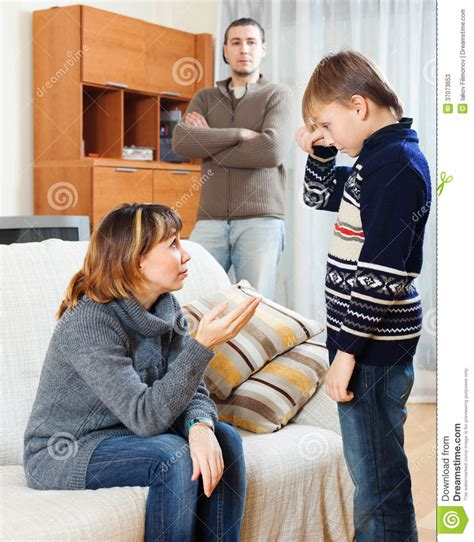 mom and son have in livingroom mother and father scolding son at living room stock photos