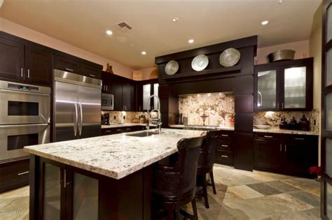 i like the dark cabinets with the light granite kitchen