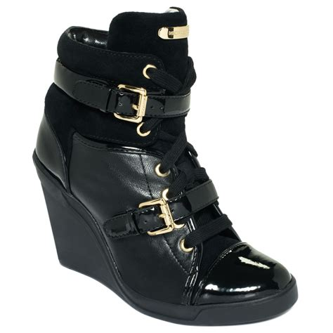 michael kors sneakers michael kors skid wedge sneakers in black lyst