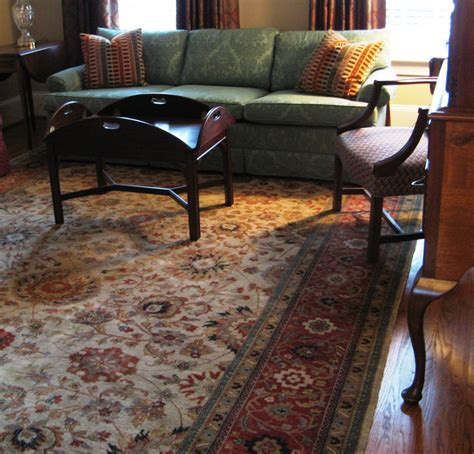 living rooms room carpet is their dining room rug that we also selected at the persian carpet