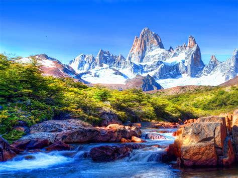 mountain scenery  snow covered river rocks beautiful