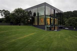 Antique old building wrapped in modern glass house box home