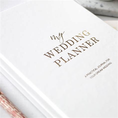 a wedding planner book gold foil wedding planner book engagement gift by blush