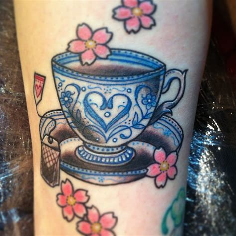 cup on teacup coffee tattoos