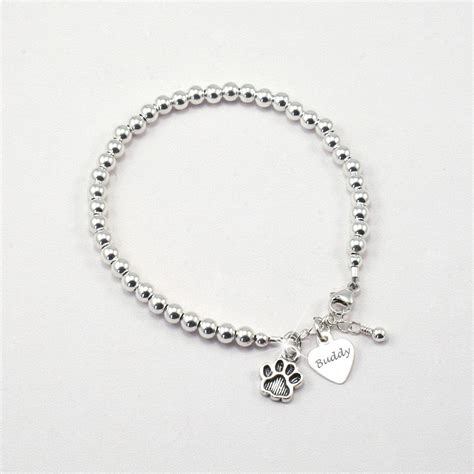 personalised pet name bracelet with paw charm someone