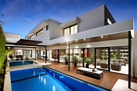 home with pool modern house with pool surrounded by a spacious deck wood