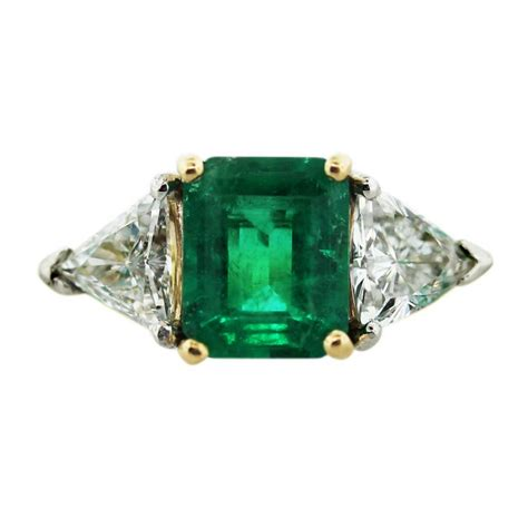 18k yellow gold emerald cut emerald ring boca raton
