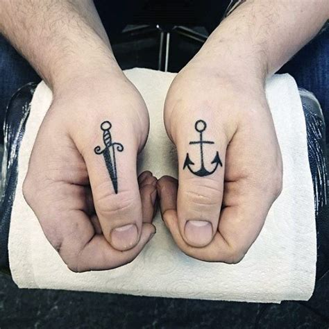 knuckle tattoo inspiration top 100 best knuckle tattoos for men a fist full of ideas